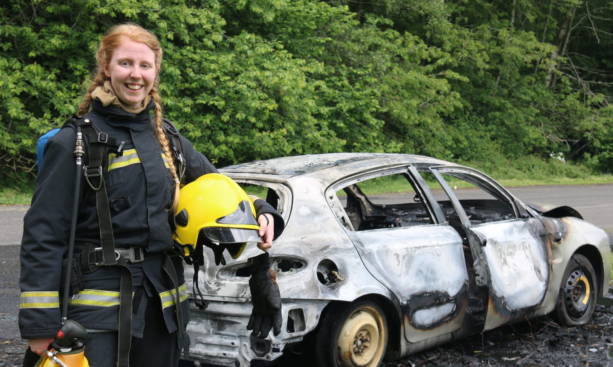 WFS member, standing next to a car during car fire training.