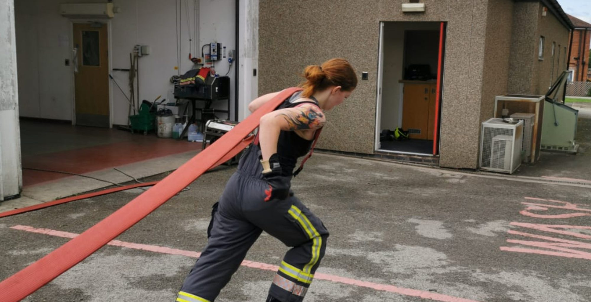 Firefighter on hose drag exercises