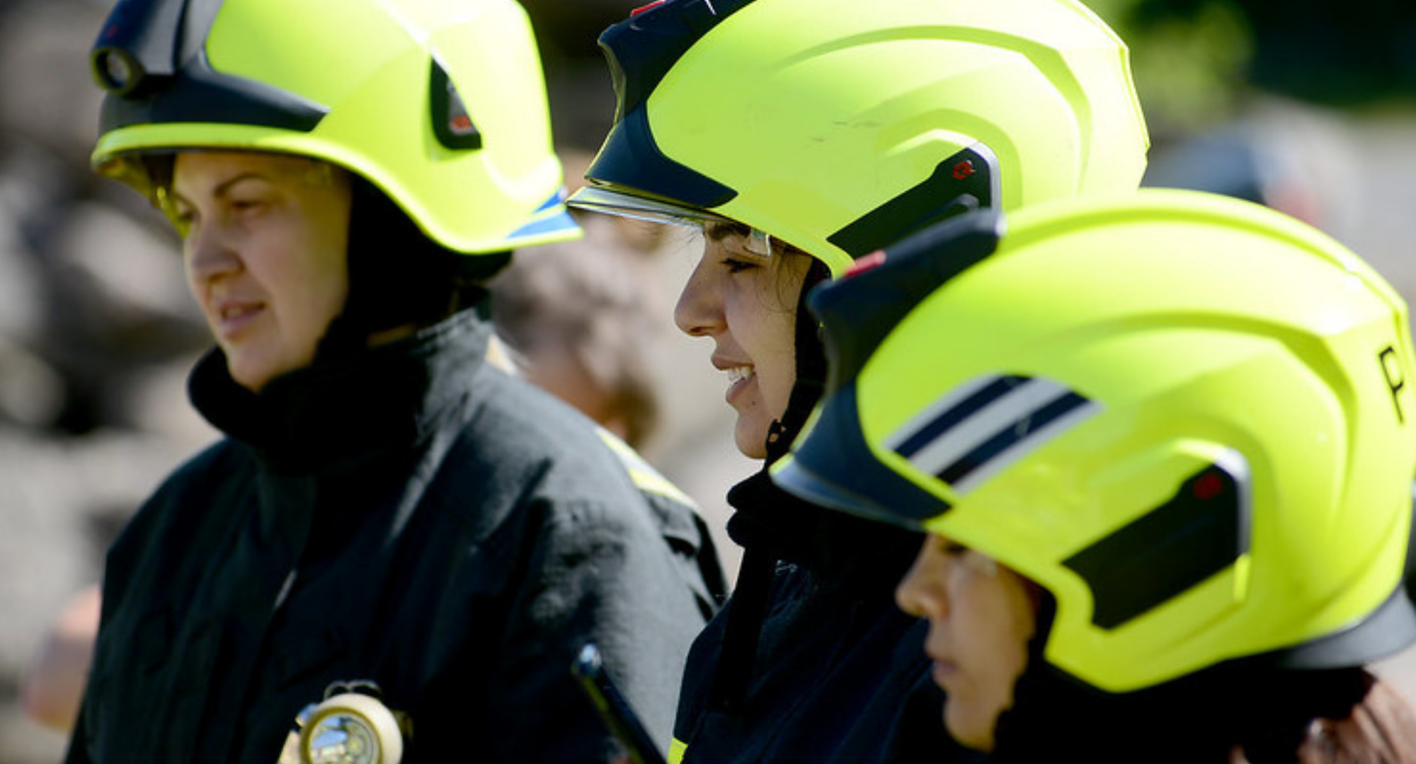 Three women firefighters standing together